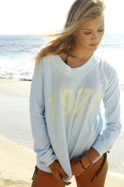 """1970"" Long Sleeve Crewneck Sweatshirt in Pacific Blue by Ash Francomb"
