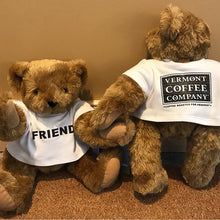 light brown teddy bear made by Vermont Teddy Bear Company wearing white tee shirt with FRIEND in black ink
