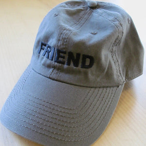 olive green baseball cap with FRIEND on front