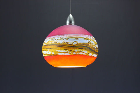 Round-Strata-Pendant-in-White-Opal-with-Ruby-and-Tangerine-on-Danielle-Blade-and-Stephen-Gartner-Eclipse-Gallery