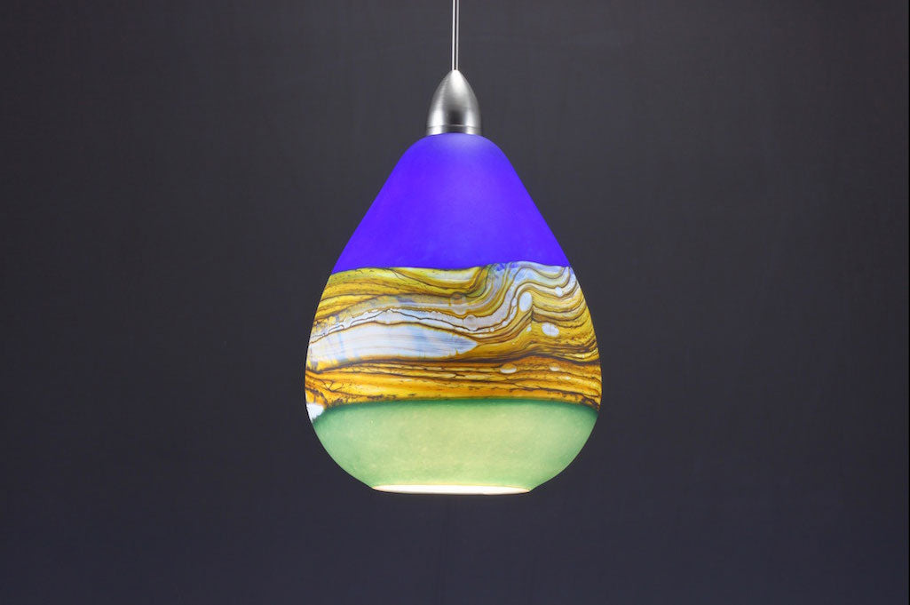Teardrop-Strata-Pendant-in-Cobalt-&-Sage-on-Danielle-Blade-and-Stephen-Gartner-Eclipse-Gallery