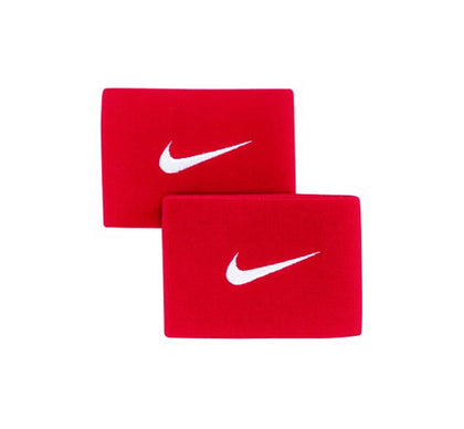 One Pair of Red Nike Guard Stays with the nike swoosh logo in the center in white all on a white background