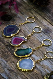 Agate slab gold rimmed key chains.