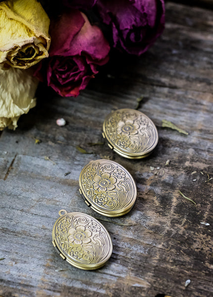 Three vintage brass lockets.