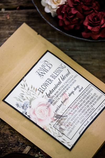 .5oz bag of Flower Blessing, on a brown background with flowers surrounding.