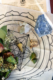 An assortment of crystals and a grid cloth.