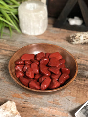 Red jasper in a bowl display.