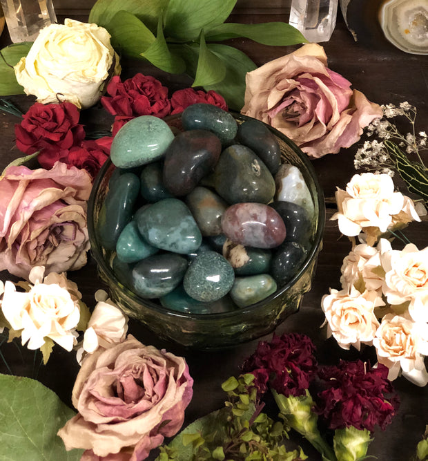 Bowl of blood-stone surrounded by flowers.