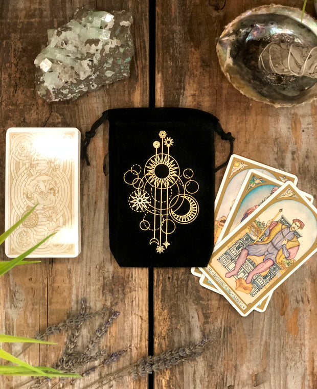 Black tarot bag with the golden printed celestial printing.
