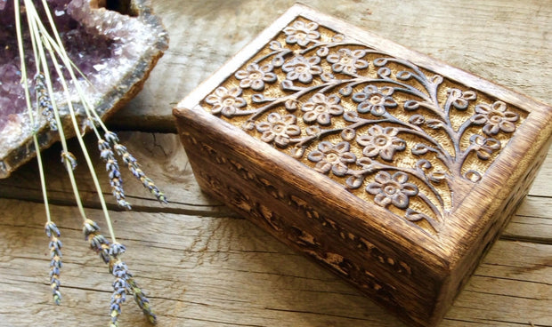 Wooden box with floral carvings.