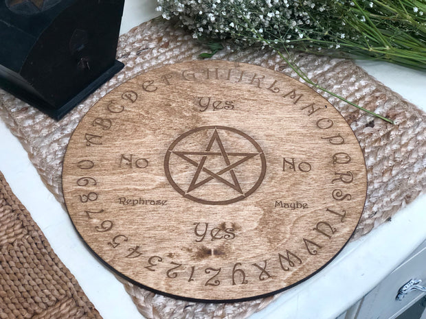 Wooden circular board engraved with symbols.