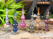 Six assorted Egyptian perfume bottles.