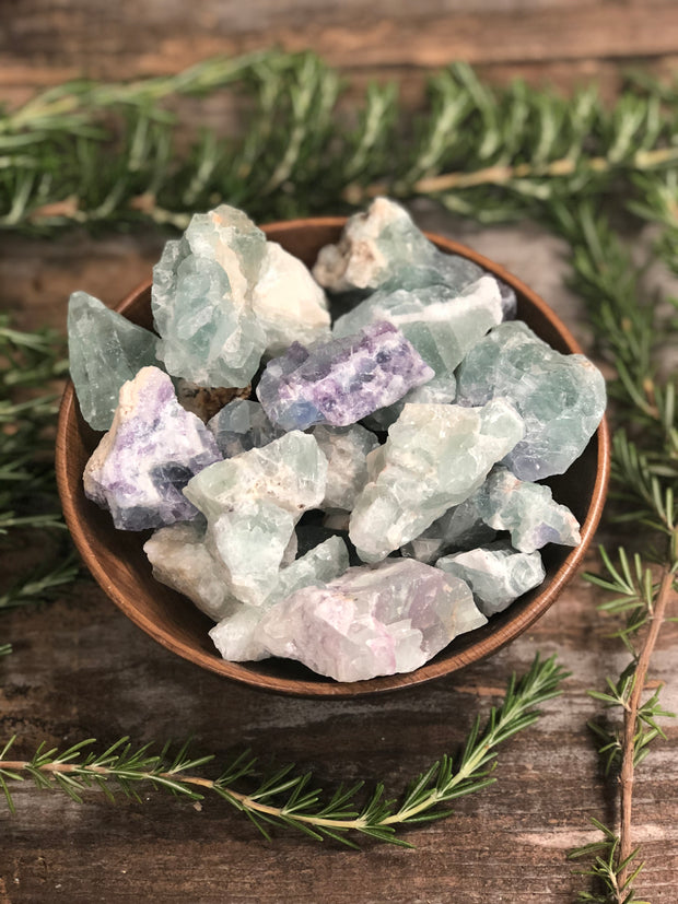 Bowl of rough Rainbow Fluorite pieces.