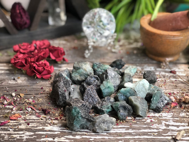 A handful of rough Emerald pieces laid out