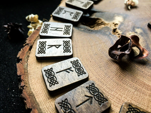 Close up of a selection of carved wooden runes.