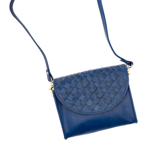 Leather clutch purse with woven flap