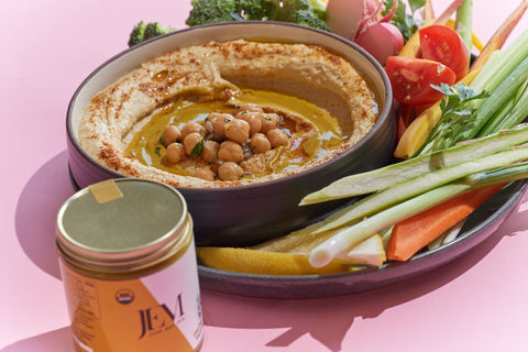 hummus with chickpeas and a side of celery, carrots and peppers