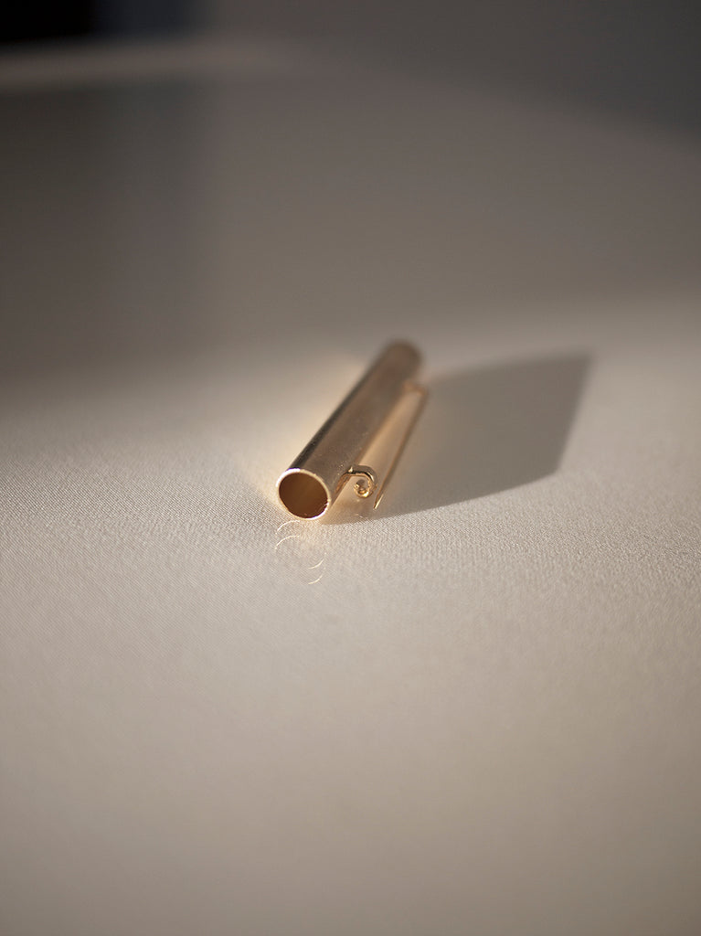 GOLDEN TUBE BROOCH