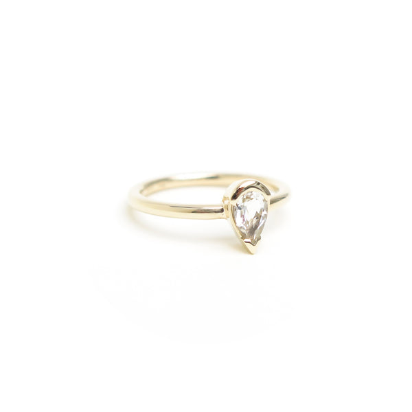 Channel Set Pear Shaped White Topaz Ring in Yellow Gold