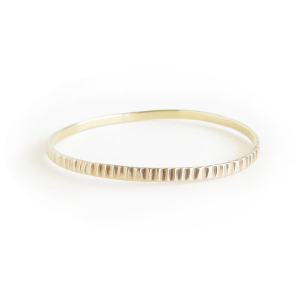 The Limpet Bangle in Brass