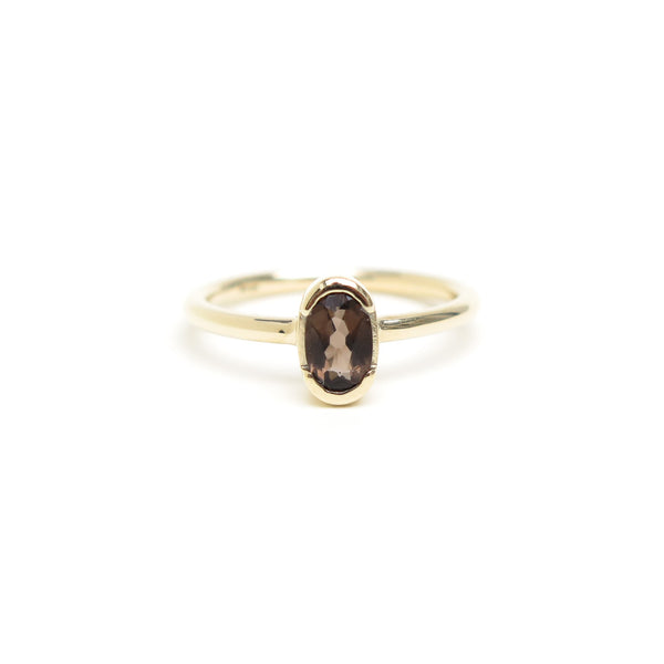 Channel Set Oval Smokey Quartz Ring in Yellow Gold