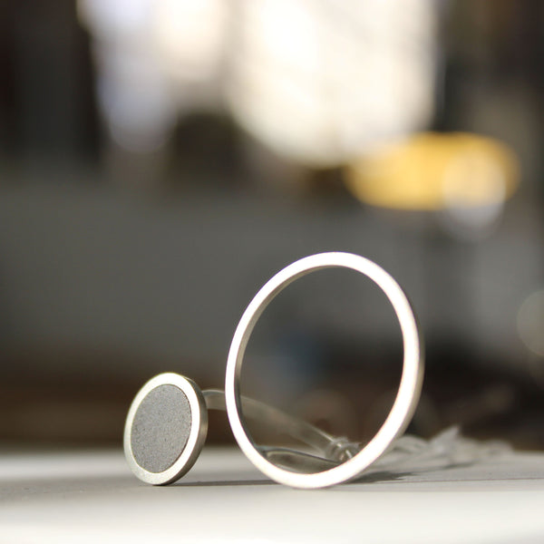 Asymmetrical Circles Concrete Ring, by BAARA Jewelry. An example of a statement minimal ring