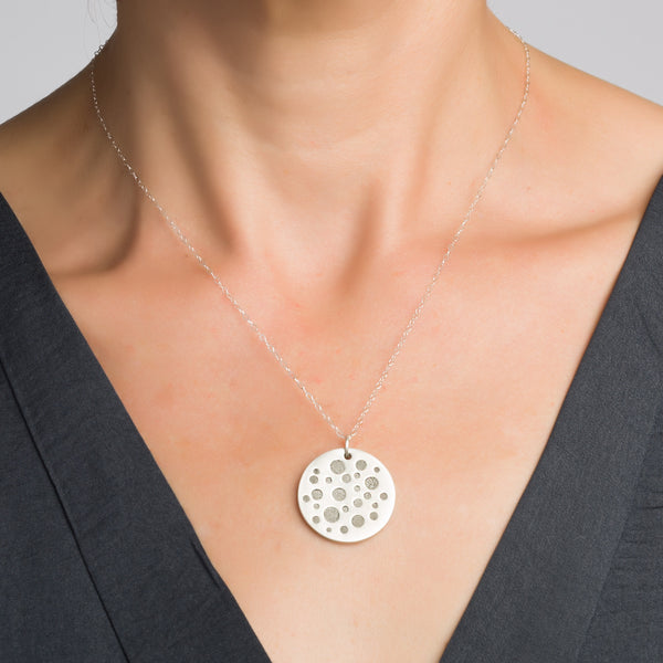 Circles Concrete Necklace, by BAARA Jewelry. Silver and Cement Handmade Double Sided Pendant.