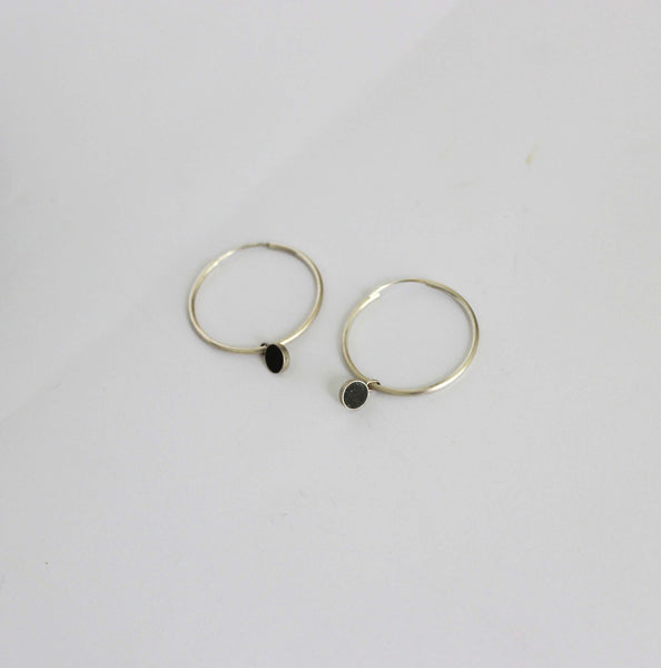 Silver hoop earrings with concrete dangle charm