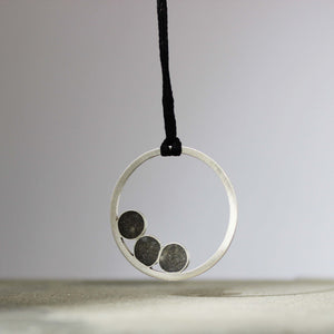 Leora Silver and Concrete Necklace, by BAARA Jewelry. Circular Pendant, Black Jewelry, Concrete Jewelry, Handmade Necklace
