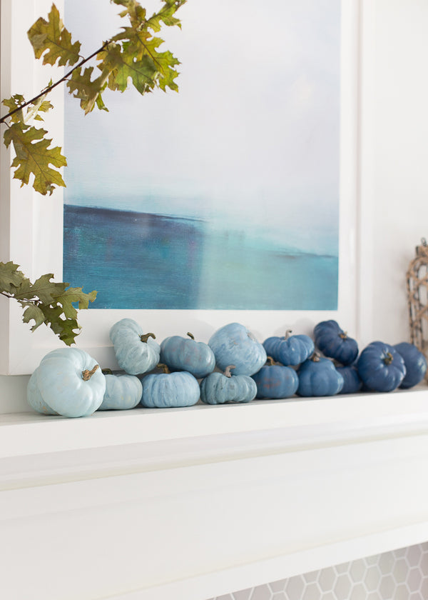 painted pumpkins on mantel in ombre blue