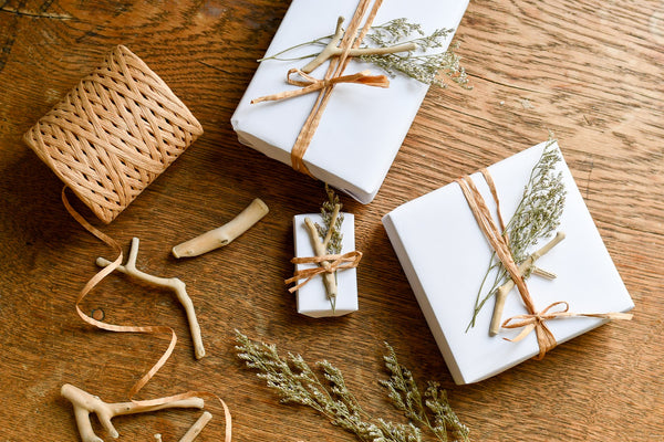 coastal christmas gift wrap with drift wood, dried flowers and twine
