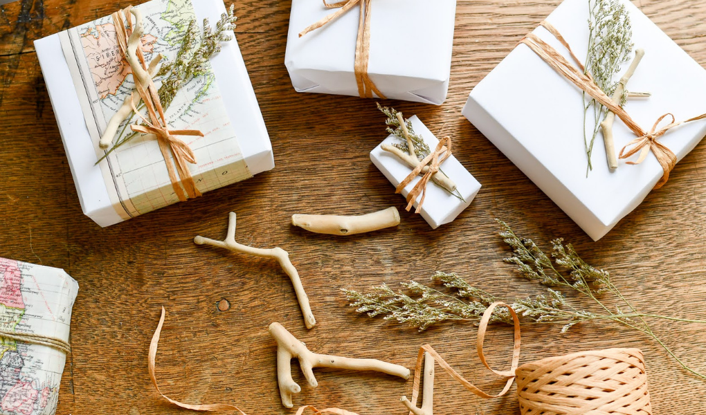 coastal christmas gift wrap with drift wood, dried flowers, and twine