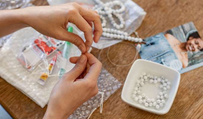 working on a sailormade whatknot beaded necklace and bracelet kit in howlite