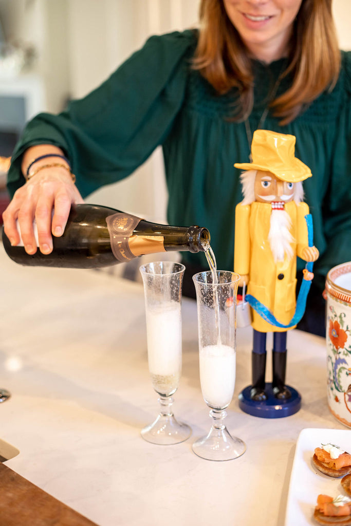 pouring champagne wearing nautical sailor stack of bracelets for women