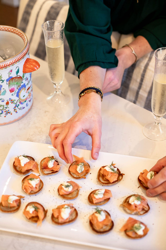 smoked salmon blinis for thanksgiving, wearing sailor stack for women and coral branch necklace