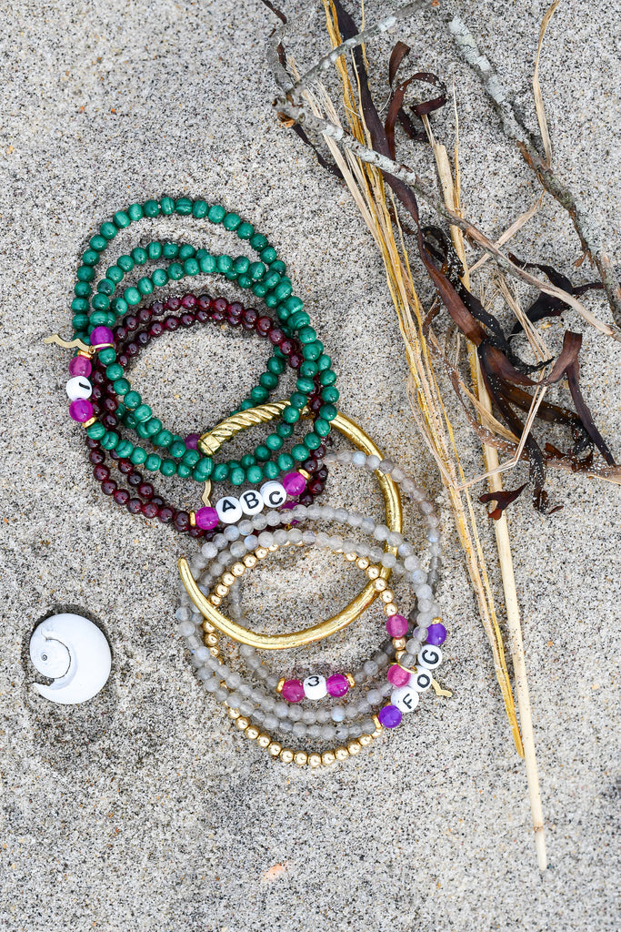 Rayminder UV Awareness bracelets for sun safety and uv protection in garnet, malachite, labradorite, gold with women's nautical stacking bracelets