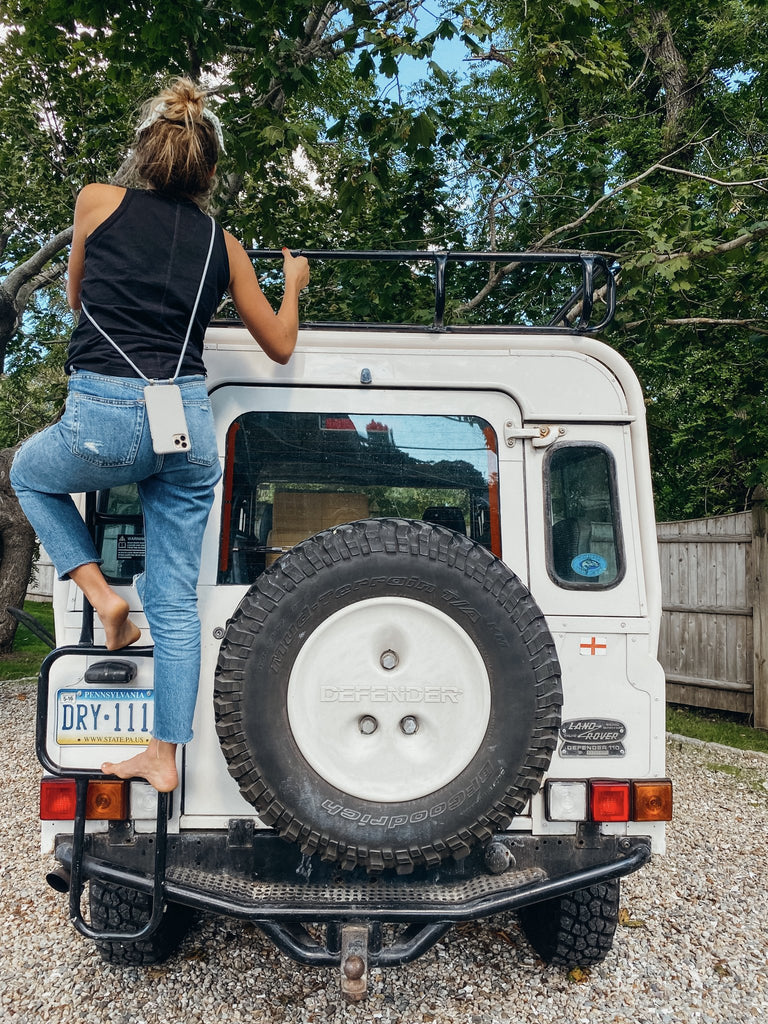 climbing on classic range rover with caep case in chatham