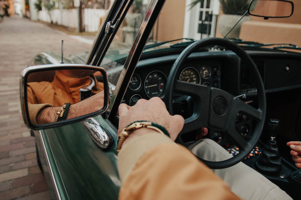 paul landry in vintage car wearing brooks brothers and sailormade nautical bracelets in Florida