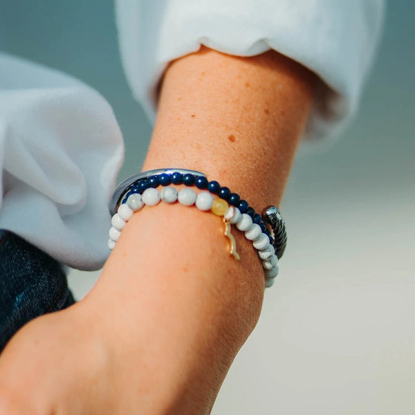 Rayminder beach bracelet | UV beaded bracelet in lapis lazuli and moonstone, with slim fid cuff in brass