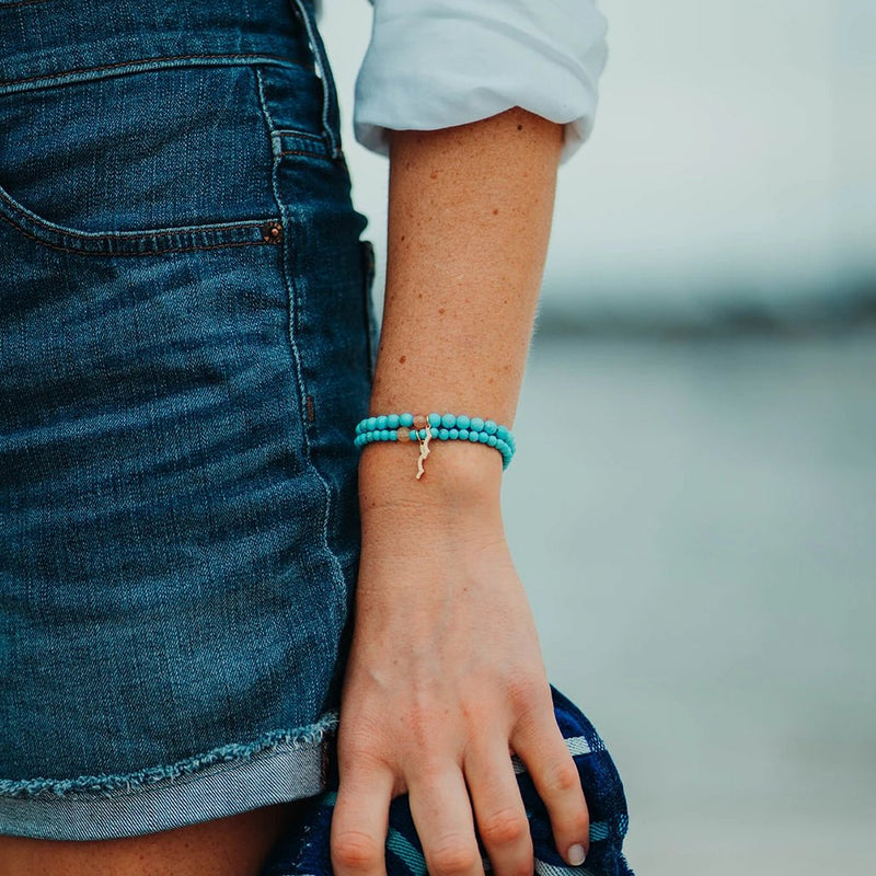 Rayminder beach bracelet | UV beaded bracelet in cyan turquoise