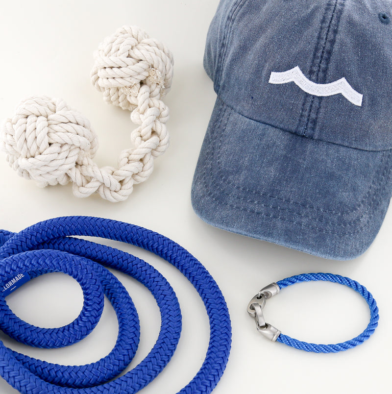 mens nautical rope bracelet, rope dog leash, rope dog toy, and hat in blue