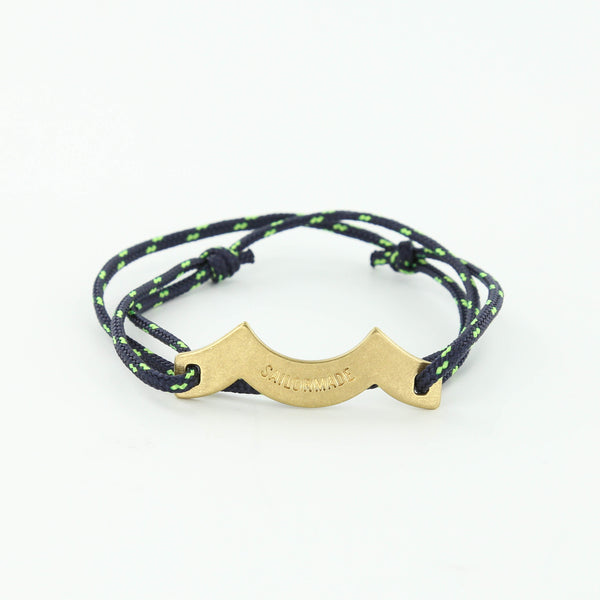 Wave Chaser Rope Bracelet in Brass in navy and neon with slip knots