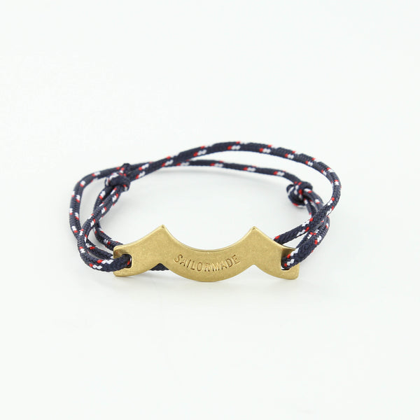 Wave Chaser Rope Bracelet in Brass in navy red and white with slip knots