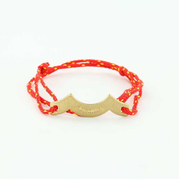 Wave Chaser Rope Bracelet in Brass in red and yellow with slip knots
