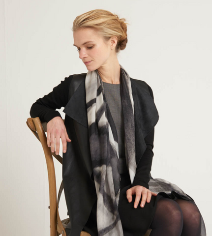 Three quarter view of the model shows a monochromatic styling with Alba Amicorum's limited edition scarf in silk chiffon. The black and white and grey shades translate ink and brush work inspired by bare trees named, Autumn's Rendition 1.