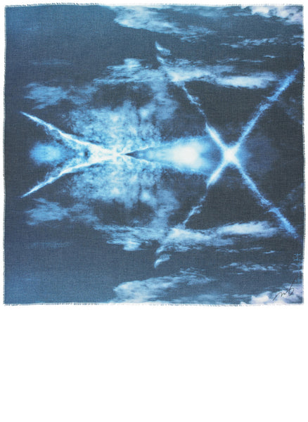 A full view of the square limited edition scarf by Alba Amicorum named beyond the atmosphere. A photograph of the blue sky taken through a prism which created angel like abstract forms.