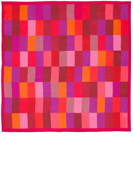 Full view of Alba Amicorum's Chroma-Lux scarf. The square limied edition silk scarf is an exploration of colour. The bright pinks dominate, but up close the complex combination of tones emerge; cooler joining the warm creating a rich dynamic purely through colour