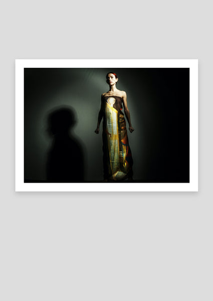 Colour photograph, staning woman
