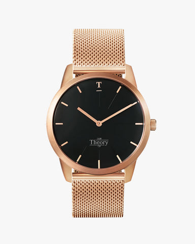 Brushed rose gold watch with a mesh strap.