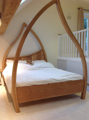 Oak Four Poster Bed with teddy bear in it !